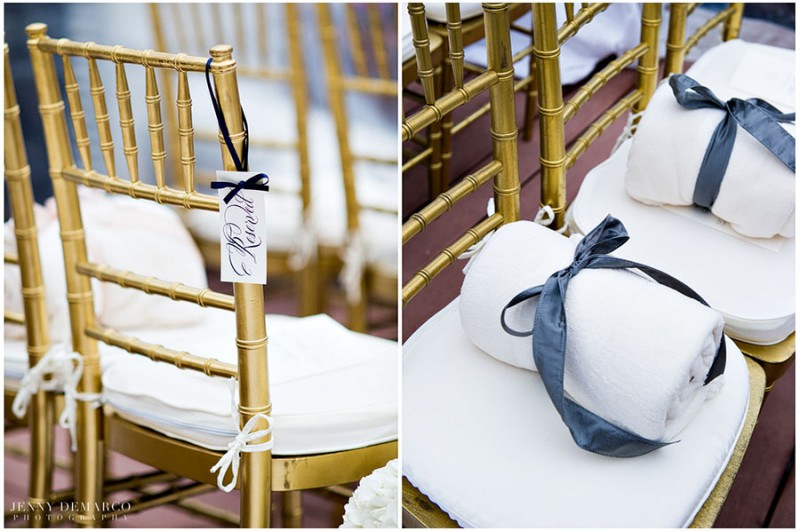 The wedding guests were offered warm, neatly rolled blankets and tied in navy blue and pale pink ribbon in case of a slight chill. The seats reserved for guests were marked with engraved cards tied by delicate navy blue ribbon.