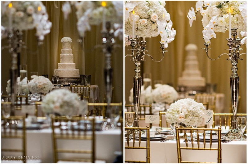 The bride's wedding cake was an elegant and delicious feature of the ballroom reception and was beautifully framed among the classic silver candle sticks and large flower center pieces.