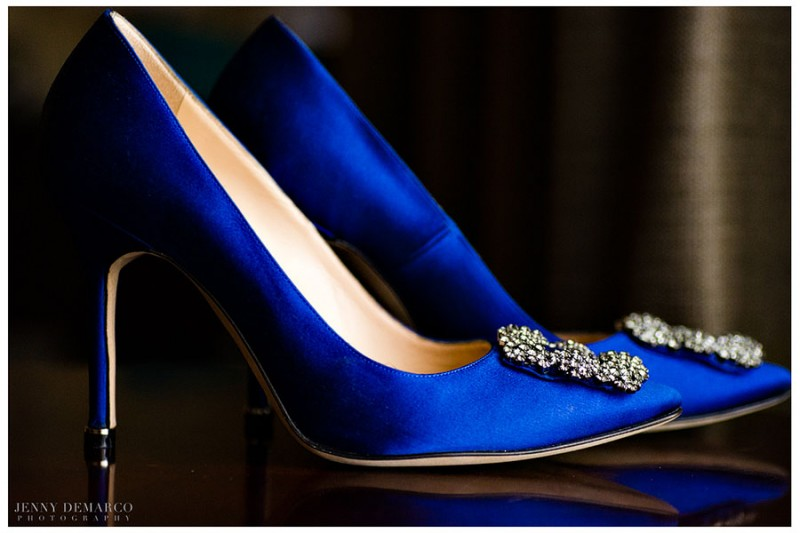 "The bride wore Manolo Blahnik Hangisi Jewel Satin Pumps. Her ""somethings blue"" were the same wore by Carrie Bradshaw in the Sex in the City Movie."
