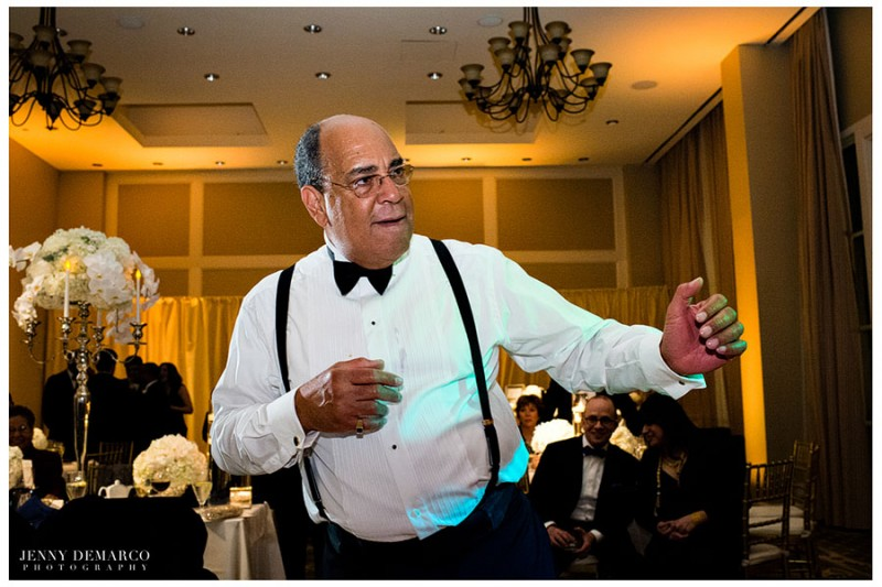 Suspenders and a bowtie are essential in order to look sophisticated on the dancefloor in the main ballroom at the Barton Creek Resort in Austin, Texas.