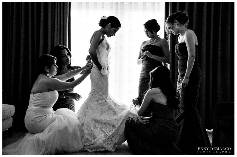 In the Fazio suite at the Barton Creek Resort, the bride is helped into her vintage lace gown by her bridesmades.