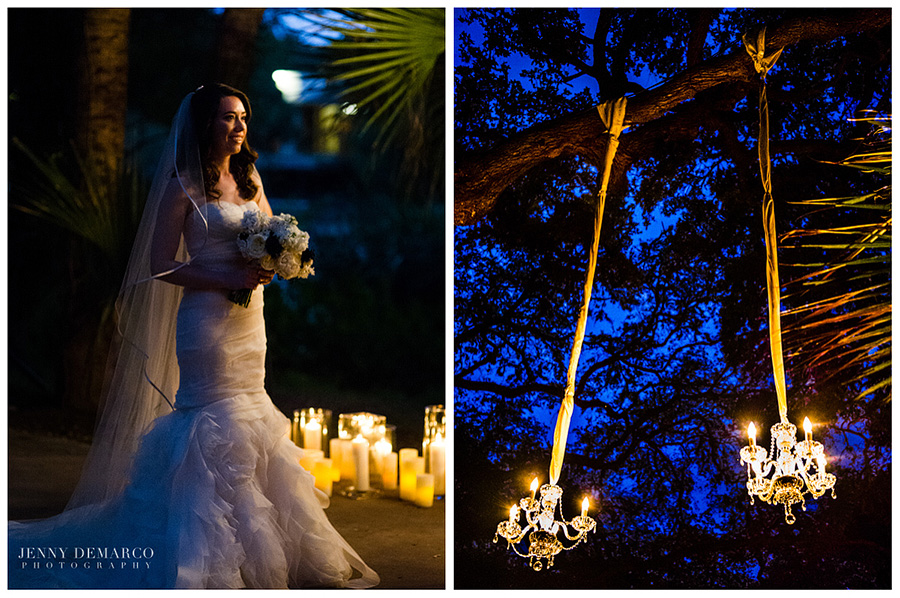 The outdoor ceremony's lighting consists of candles and chandeliers hanging off trees.