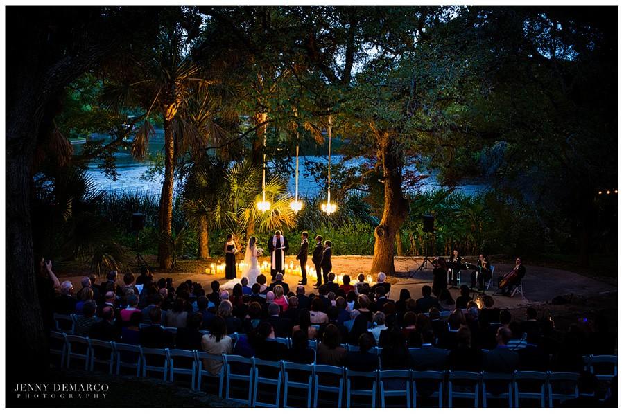 A beautiful outdoor wedding ceremony at Laguna Gloria along Lake Austin.