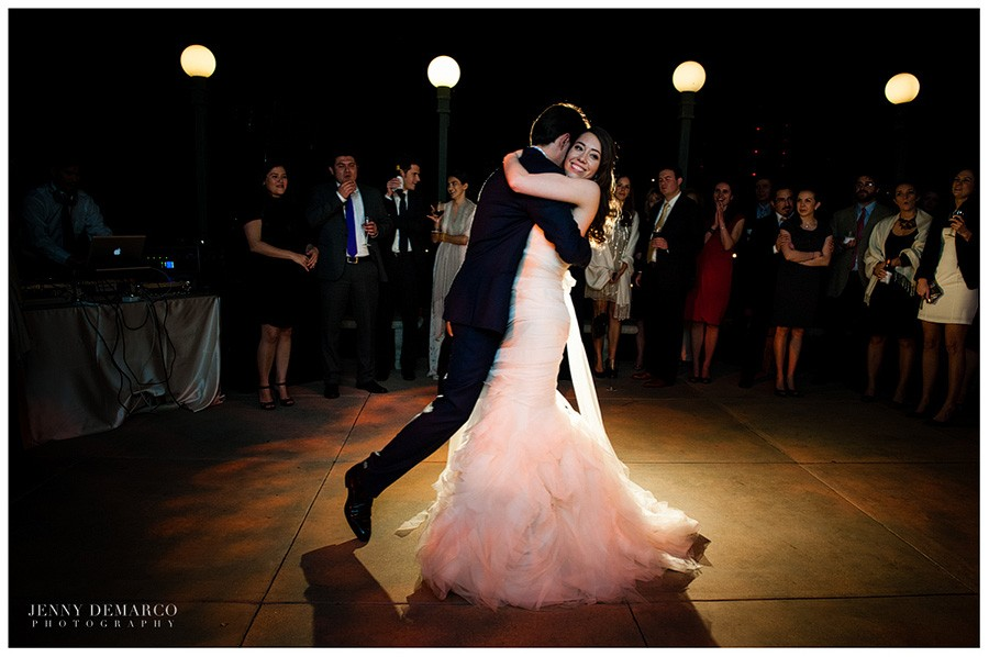 The bride and groom dance the night away at their black tie wedding reception.