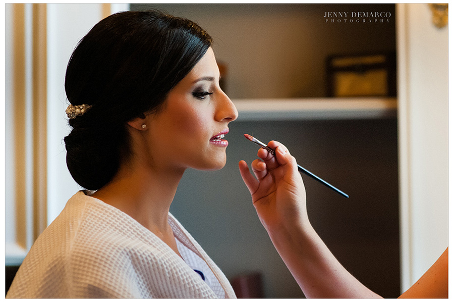 Rachel getting her make-up done before the ceremony by the make-up artist.