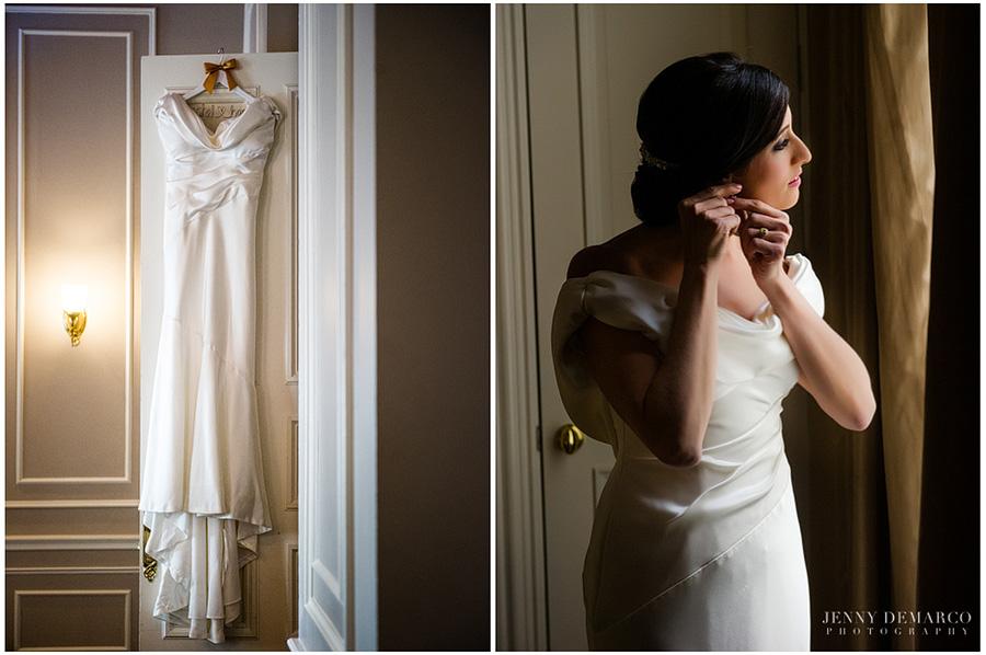 Rachel's classic designer wedding dress hanging.