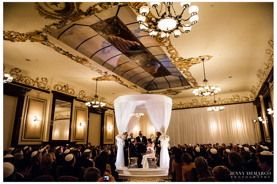 The jewish huppah is centered directly under the vaulted trompe l'oeil dome in the Driskill Ballroom for Rachel and Ben's wedding.