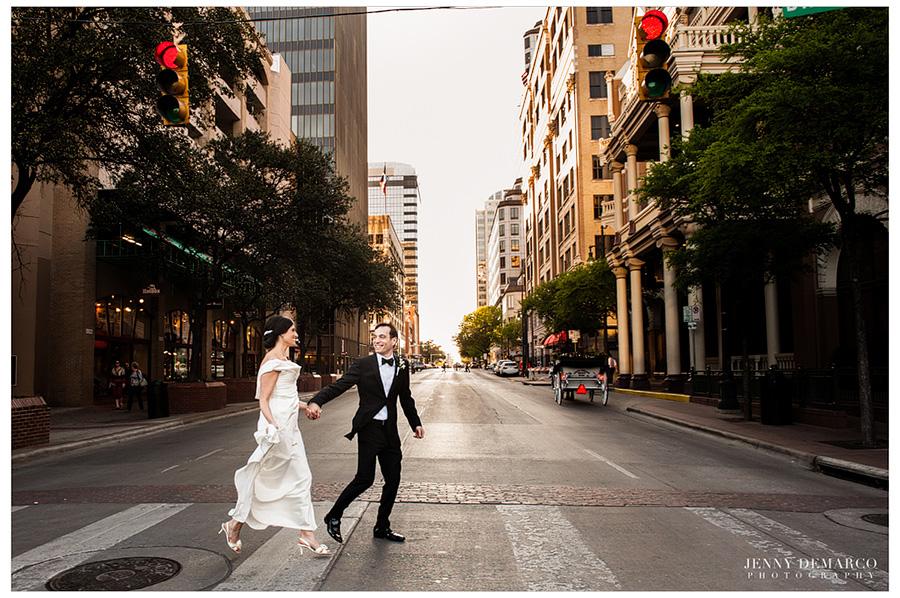 Rachel and Ben walking downtown Austin, Texas to celebrate at their reception.