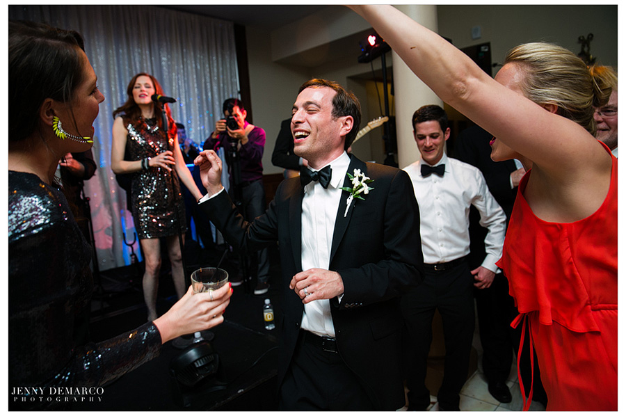 Ben dancing with guest at their wedding reception at the Driskill Hotel in Austin, TX.