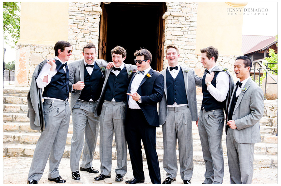 The groomsmen laughing together in front of Ian's Chapel.