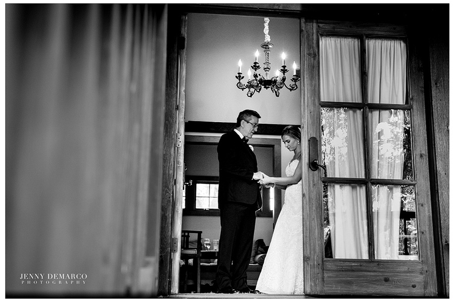 The bride and her father are spending a moment together before he walks her down the aisle.