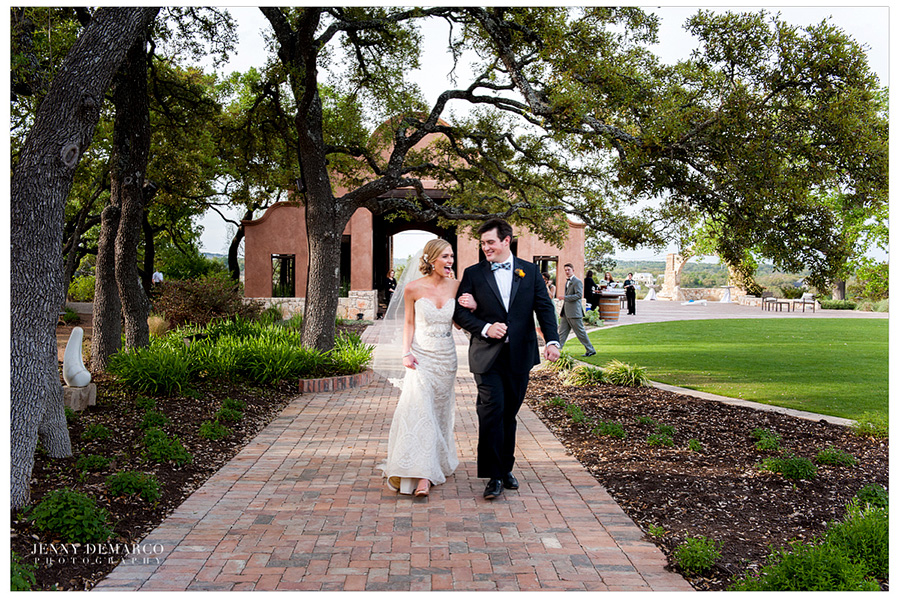 The bride and groom walking together after the wedding ceremony in front of Ian's Chapel pavilion.