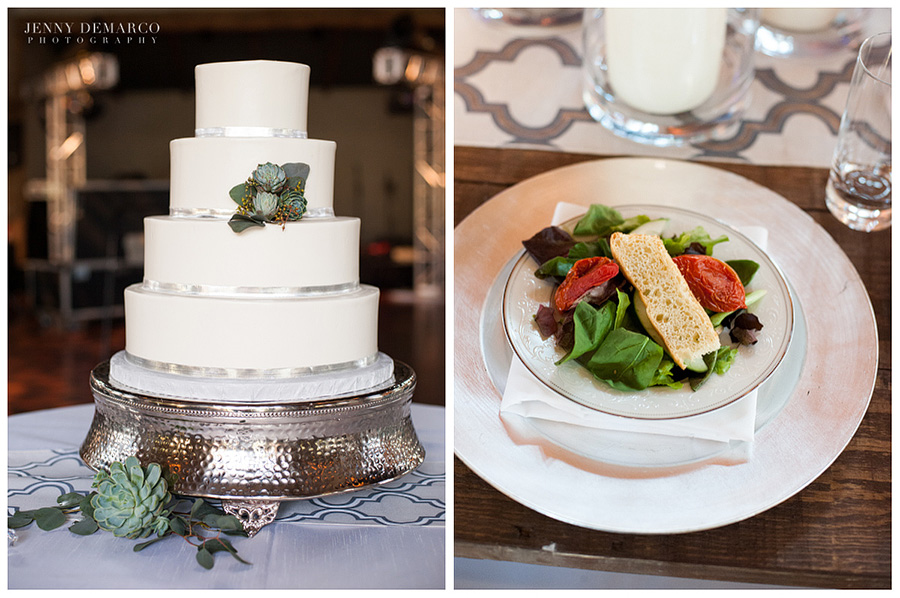The wedding cake is white with silvery green echeverias on it. The guests were served a salad with spinach, tomato, and bread.