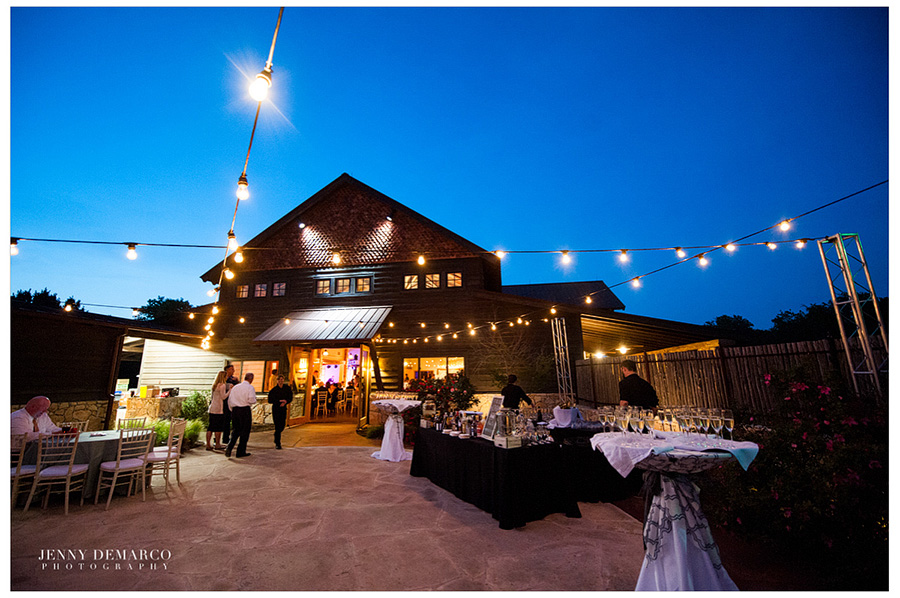 The Ian's Chapel Events Hall is decorated outside with lightbulbs hanging on lines and a table full of refreshments.