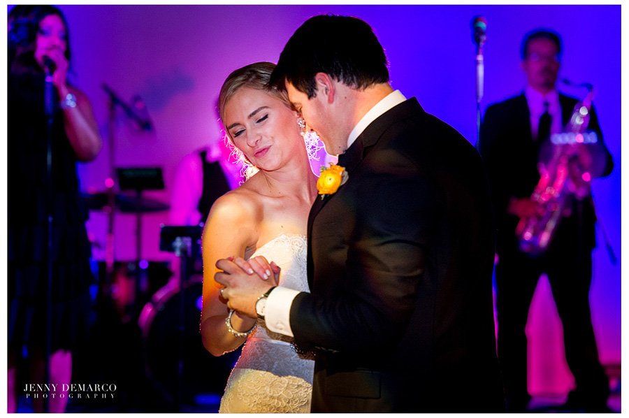 The bride and groom are having their first dance a the Ian's Chapel Events Hall interior.