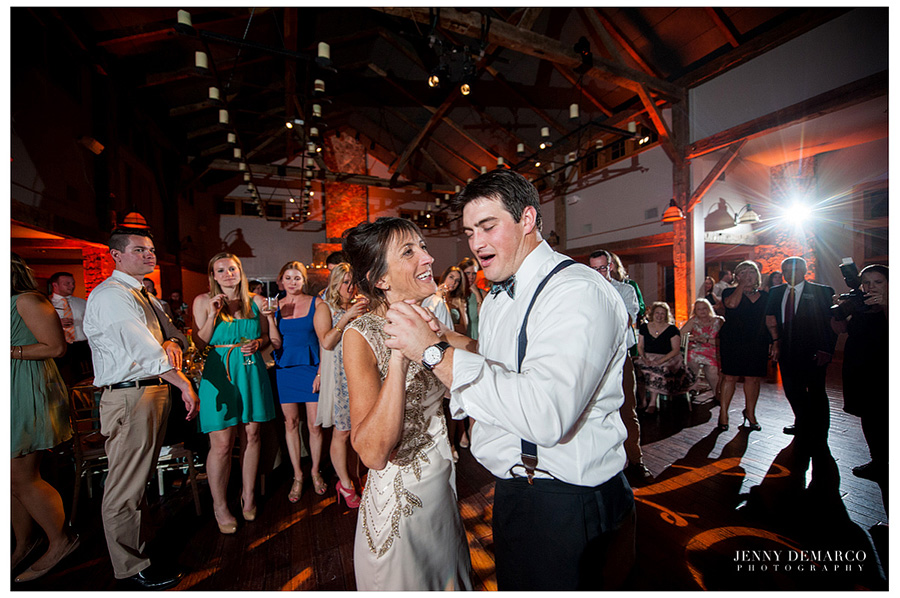 The groom is dancing with his mother in the Ian's Chapel Events Hall.