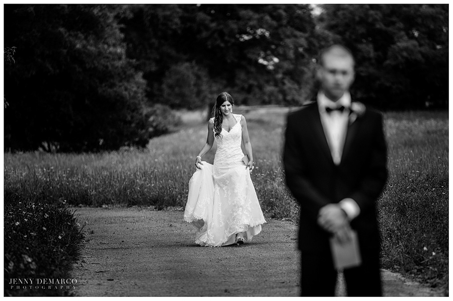 Shelby walking to her groom in the vineyard before their wedding ceremony for their first look.