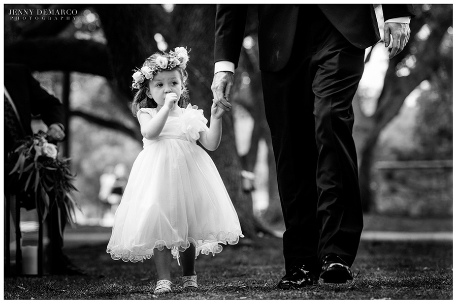 The flower girl, Leighton Walker, walking down the aisle during the ceremony.