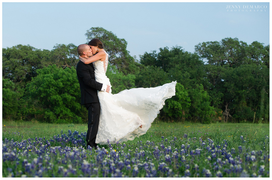 Chad lifting Shelby in the beautiful Texas bluebonnets at the Vineyard at Chapel Lodge.