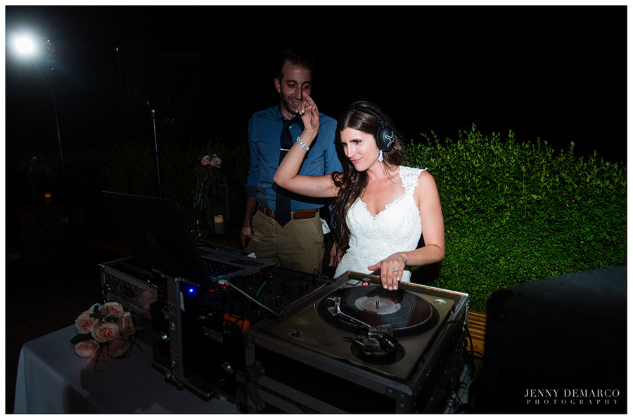 Shelby, the bride, as the guest DJ; celebrating her reception.
