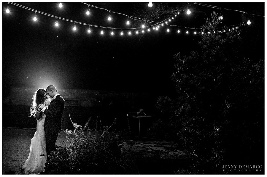 Shelby and Chad at the end of the night underneath the stars and lights sharing a romantic moment.