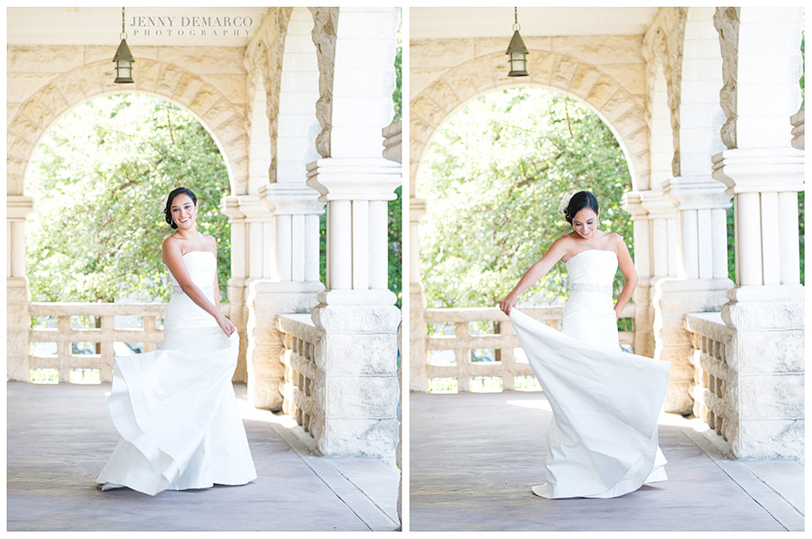 The bride is twirling her wedding dress on a beautiful porch with stone archways and columns.