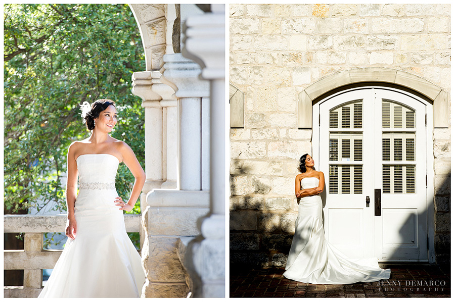 The Bride is standing outside on a porch with a stone archway and columns with lovely green scenery in the background. The bride is standing outside on a brick pavement next to tall white double doors on a white stone building to match her white dress.