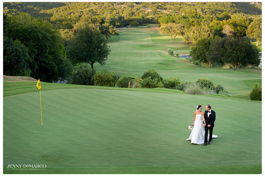 The Bride and Groom walk across the Barton Springs golf course in their black tie wedding attire.