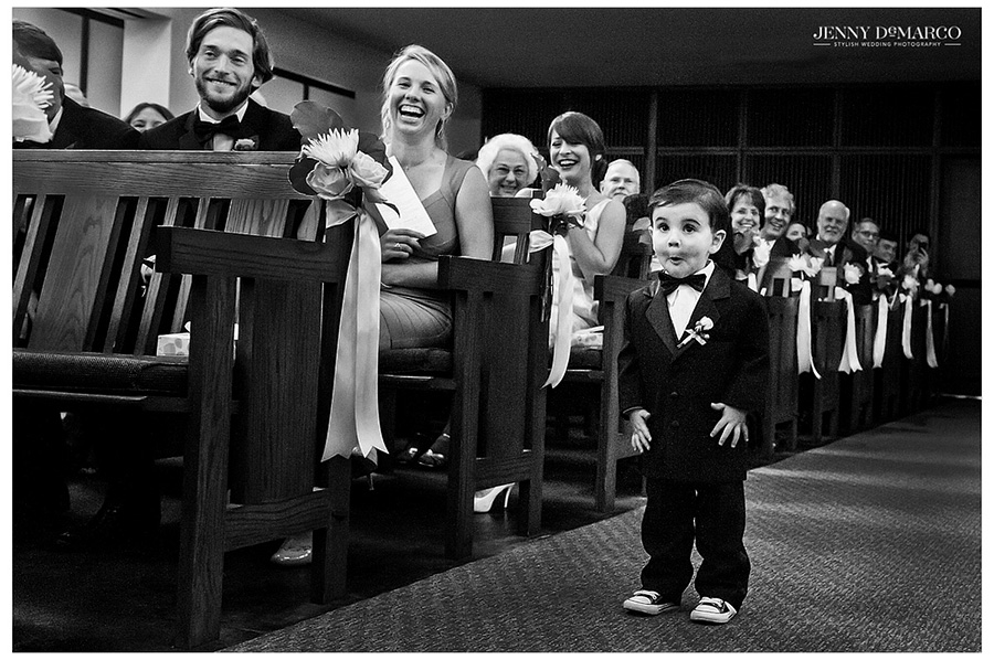The bride's precious ring bearer marches down the aisle of the ceremony with excitement.