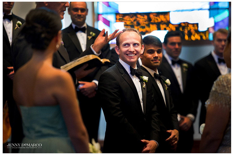 Sam flashes a smile as his bride walks down the aisle to meet him at the alter of their Barton Creek wedding.