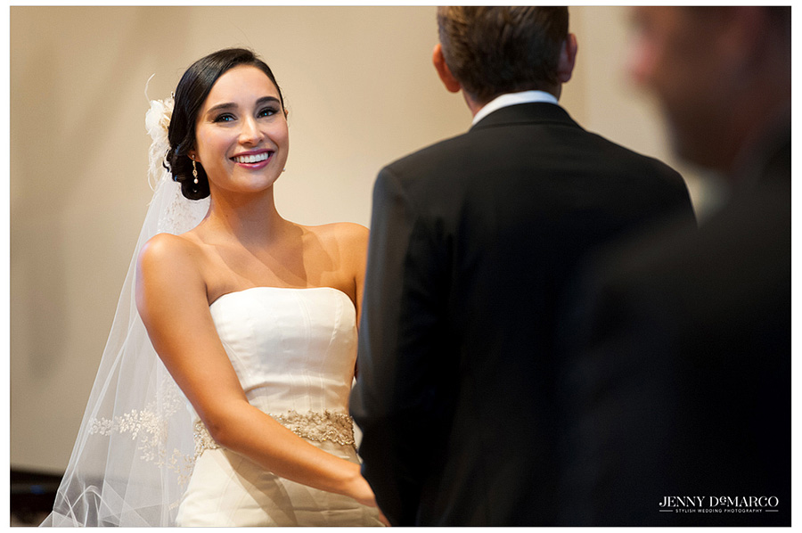 The beautiful bride looks  excited as she takes Sam's hand in marriage during their ceremony at Barton Creek Resort.