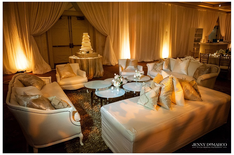 The guest lounge creates the perfect resting and social area at the wedding reception with couches, florals and comfort.