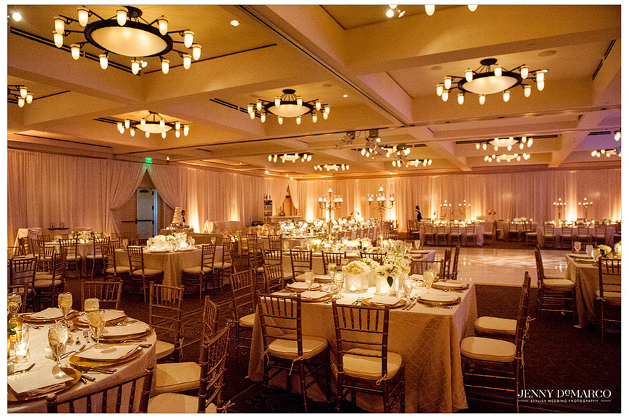 Barton Creek Resort's grand ballroom creates the perfect black tie wedding reception event because of it's warm uplighting and classic character.