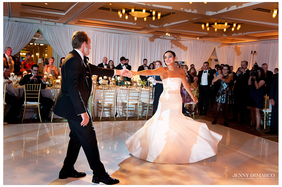 The groom spins the bride during his special moment with her on the dance floor at Barton Creek Resort.
