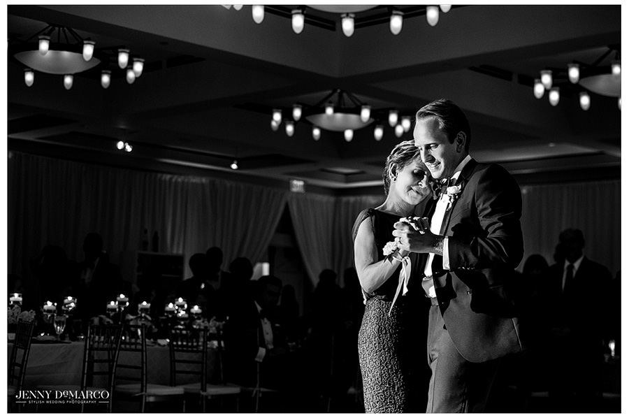 The groom's mother enjoyed a moving moment with her son during the wedding reception at Barton Creek Resort in Austin.