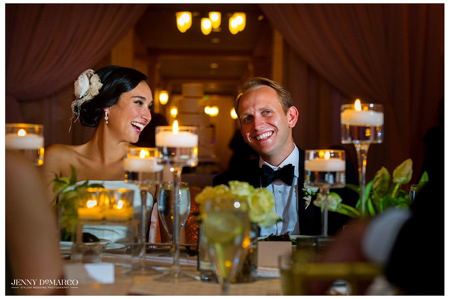 Stephanie and Sam enjoy a moment alone at their table during their indoor, black tie ballroom reception.