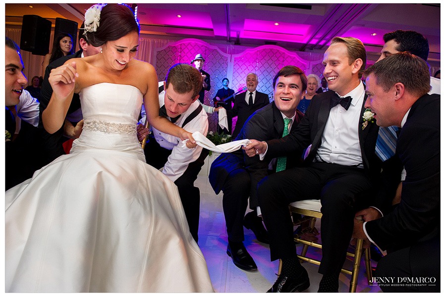Traditions are an important part of weddings, this Jewish couple affirms their vows and love for each other through tradition and heritage at their wedding reception.