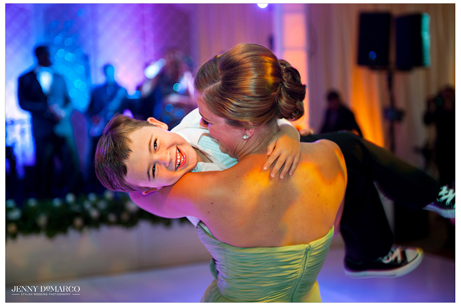Stephanie's bridesmaid takes a waltz on the dance floor with the adorably cute ring bearer at the reception.