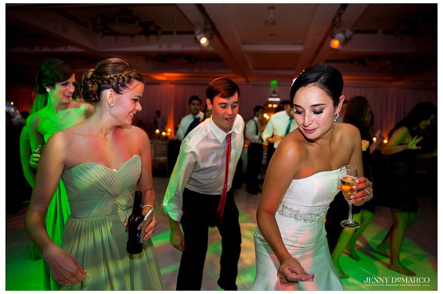 Stephanie dances the night away on the dance floor to a fun Austin wedding band.