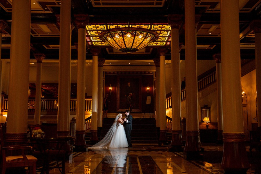 Bride and groom dance in the lobby of the historic Driskill Hotel.