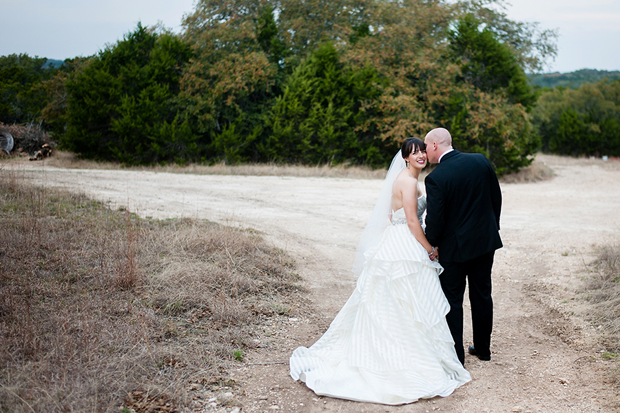 Bride and groom portrait along the dirt road in the rustic countryside