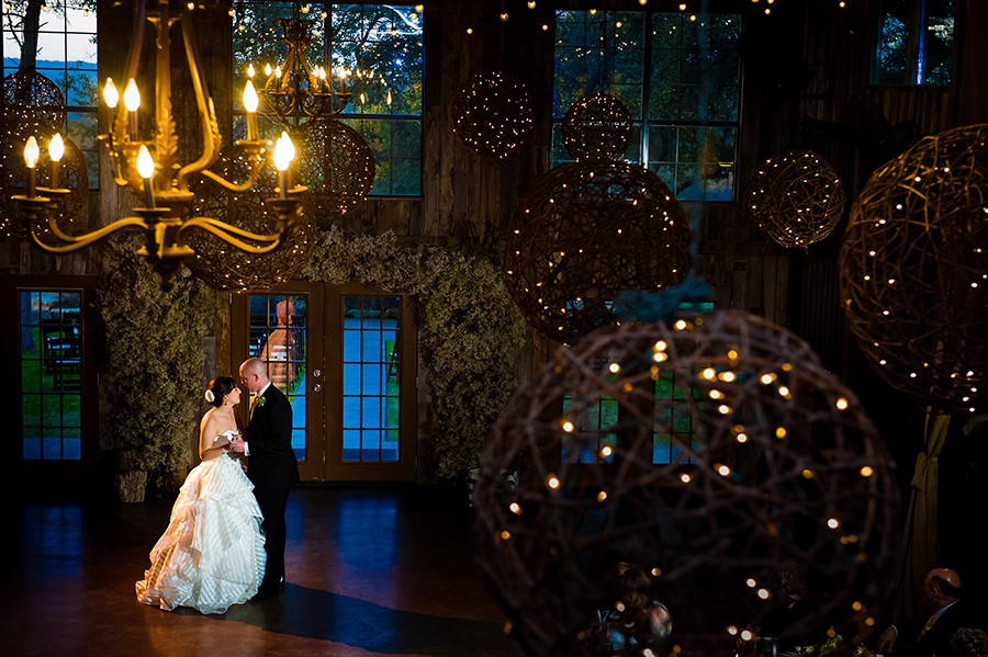Bride and Groom taking their first dance at twighlight