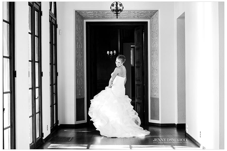 Bride dances into the cut limestone sun room.