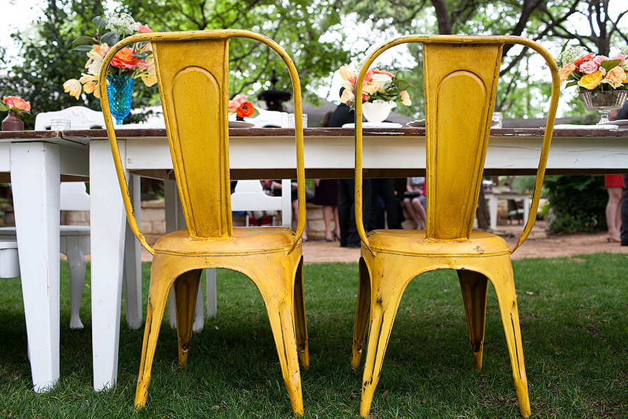 yellow metal bucket chairs