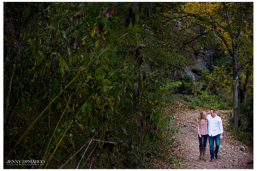 Couple walking along the path in the greenbelt.