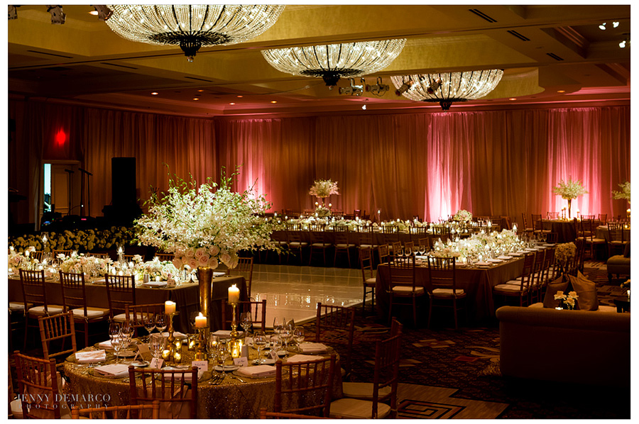 The Four Seasons Ballroom in Austin is glamorously decorated for a black tie luxury wedding reception.