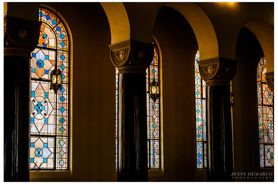 Sunshine peaks through the stained glass and columns giving a warm glow to Central Christian church in downtown Austin.