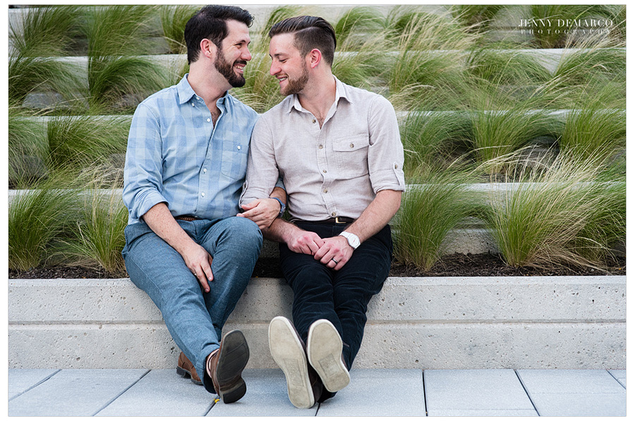 Two cute gay men sit at the J.W. Marriott Hotel in downtown austin.