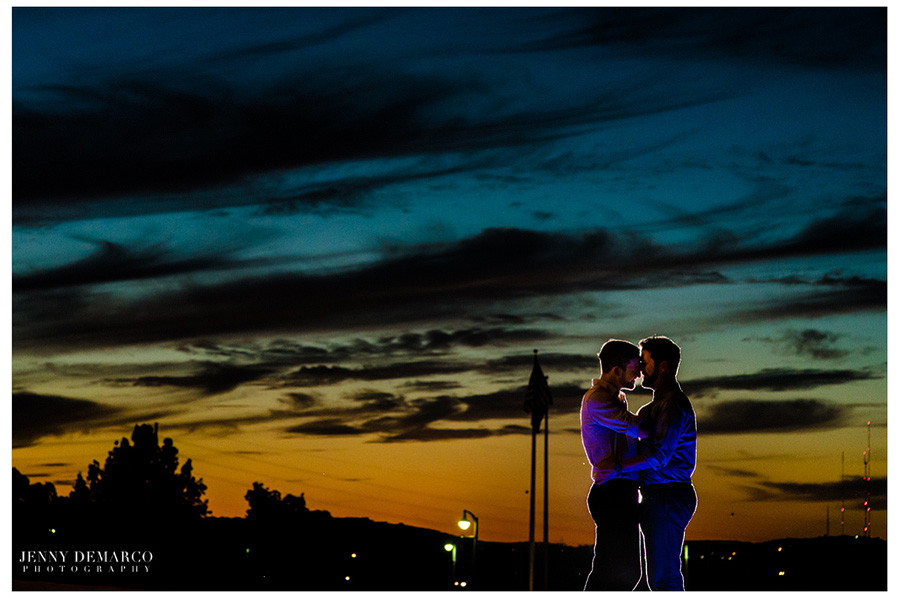 A colorful texas sunset in the background of this same sex engagement session.