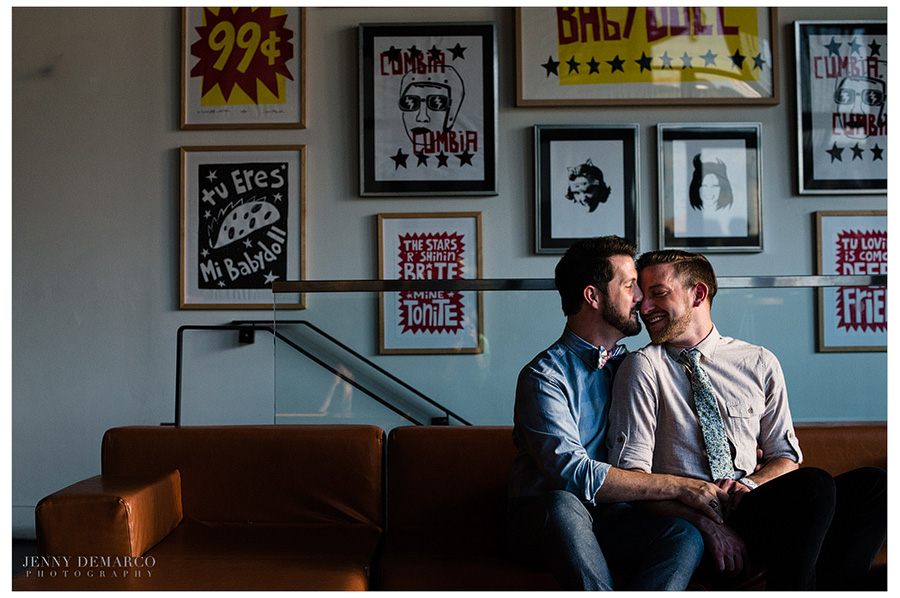 Same sex couple cuddles on the couch at Malverde for their modern engagement session.
